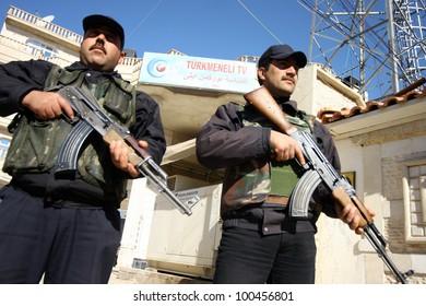 KIRKUK, IRAQ - FEBRUARY 2: Unidentified Iraqi soldiers stands guard on a check point on February 2, 2007 in Kirkuk, Iraq.
