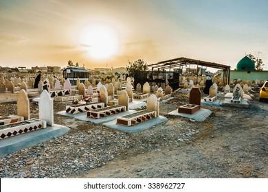 Kirkuk, Iraq - October 21, 2015: Iraqi muslim tombs located in Public graveyard in Kirkuk city