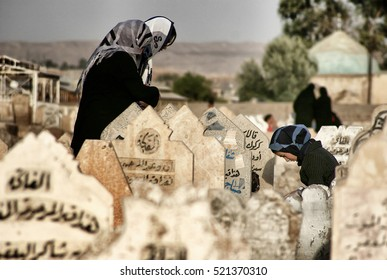 Kirkuk,Iraq - September 01,2005 : Thousands of people lost their lives in the war in Iraq.Family waiting at the grave of your people