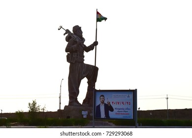 KIRKUK,IRAQ- SEPTEMBER 25:Kurdish military sculpture in the city entrance on September 25, 2017 in Kirkuk,Iraq