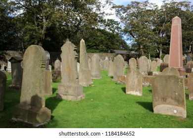 Kirkwall - Orkney (Scotland), UK - August 07, 2018: 12th century Romanesque Saint Magnus cathedral cemetery in Kirkwall, Orkney, Scotland, Highlands, United Kingdom