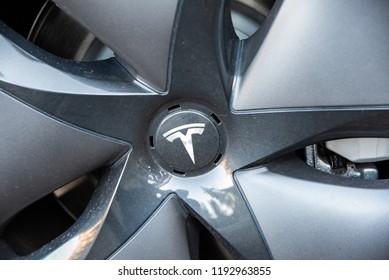 KIRKWOOD, CA/U.S.A. - SEPTEMBER 29, 2018: An abstract, close up photo of a close up of a Model 3 Tesla hubcap.