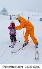 Kiroro Ski Resort, Hokkaido, Japan - December 6, 2014. Trainer is on training child to play snow skiiing that is favorite sport in winter both kids and adults are able to play together.