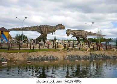 KIROV, RUSSIA - AUGUST 30, 2017: Tyrannosaurus Rex and carnotaurus. Sculptures of predatory dinosaurs in the children's Park