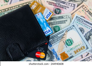 KIROV, RUSSIA - JANUARY 18, 2015: Photo of VISA and Mastercard credit card in leather wallet with USA dollars bills