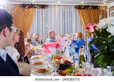 Kirov, Russia - January 24, 2019: Guests at the wedding Banquet at the richly laid table. Russian traditional holiday with alcohol