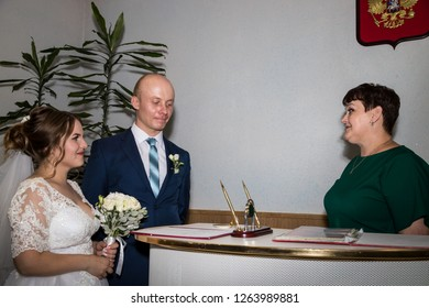 Kirov, Russia - July 27, 2018: Bride and groom befory ceremony of registration marriage in registry office