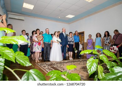 Kirov, Russia - July 27, 2018: Bride, groom and guests during ceremony of registration marriage in registry office