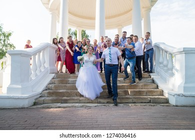 Kirov, Russia - July 27, 2018: Bride, groom and guests outdoors after ceremony of registration marriage in a summer day