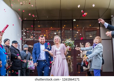 Kirov, Russia - June 29, 2018: Bride, groom and guests outdoors after ceremony of registration marriage in an autumn day