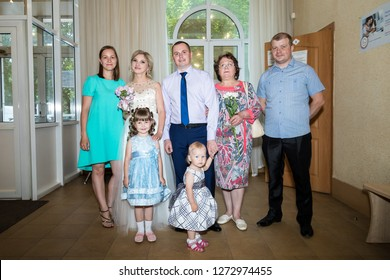 Kirov, Russia - June 29, 2018: Bride, groom and guests indoors after ceremony of registration marriage