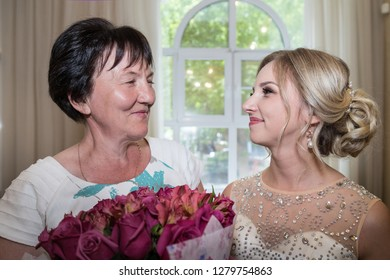 Kirov, Russia - June 29, 2018: Bride and her mother together before ceremony of registration marriage in registre office