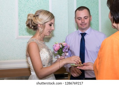 Kirov, Russia - June 29, 2018: Bride and groom together befory ceremony of registration marriage in registry office