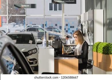Kirov, Russia - March 06, 2018: Cars and manager in showroom of dealership AVTOVAZ named SeverAvto in Kirov city in 2018. Top view