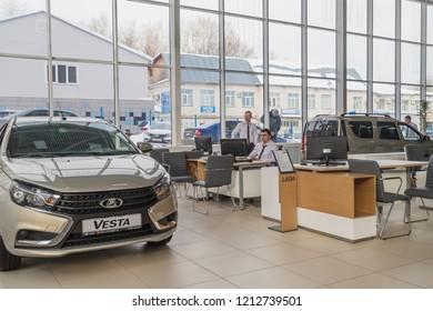 Kirov, Russia - March 06, 2018: Cars and manager in showroom of dealership AVTOVAZ named SeverAvto in Kirov city in 2018