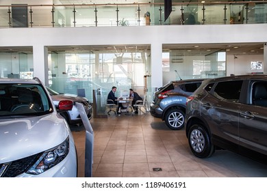 Kirov, Russia - March 14, 2018: Manager in showroom of dealership Nissan in Nizhny Novgorodcity in 2018