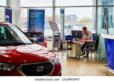 Kirov, Russia - May 07, 2019: Manager in showroom of dealership Datsun in Kirov in 2019