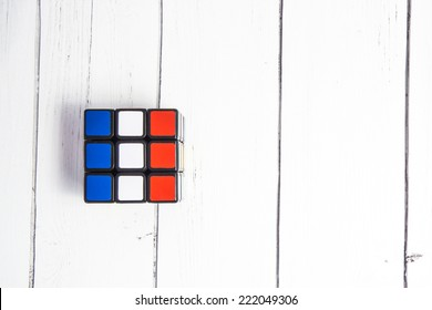 KIROV, RUSSIA - OCTOBER 06, 2014: Rubik's cube on the white background. Rubik's Cube invented by a Hungarian architect Erno Rubik in 1974. Rubik Cube with flag of France