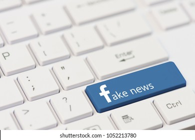 KIROVOGRAD, UKRAINE, MARCH,12,2018 - key with text Fake News on white laptop keyboard. Facebook style.