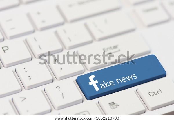 KIROVOGRAD, UKRAINE, MARCH,12,2018 - key with text Fake News on white laptop keyboard. Facebook style.