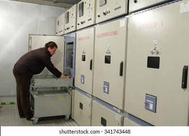 Kirovsk, Murmansk region, Russia - September 4, 2007: Metal-Clad high Voltage  switchgear panel room, Electrical engineer  make maintenance  electrical switchboard mining plant.