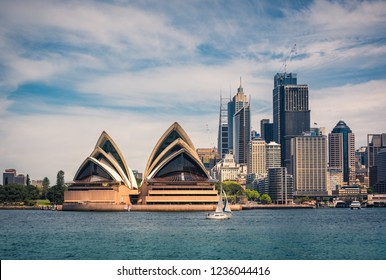 Kirribilli, Sydney, Australia - October 23, 2018:  View from across the bay at Kirribilli of the Opera House and the City Skyline with a sail boat in Sydney Harbour, Australia.