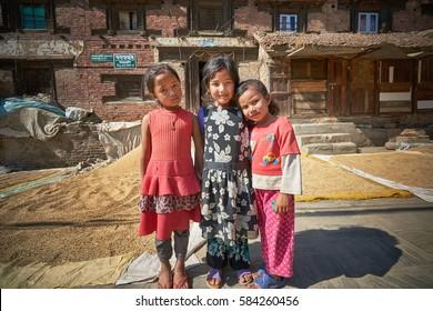 KIRTIPUR/NEPAL - NOVEMBER 13, 2016: Three nepalese girls posing in the Kirtipur city of Nepal