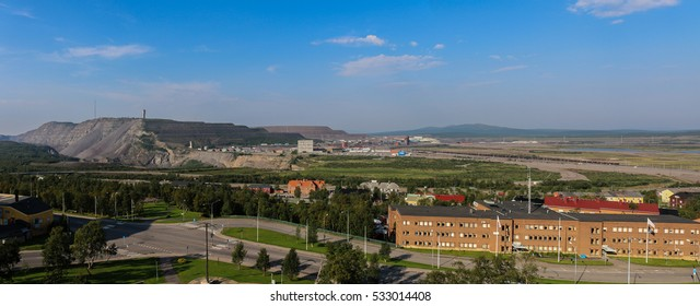 Kiruna, Sweden - August 6, 2014: View over Kiruna and the mines. The mines are expanded more and more, so at some point the whole city has to move.
