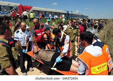 KIRYAT GAT, ISR - SEP 20 2009:An injured passengers getting out from a train cars that derailed. An estimated 1,000 people die in train accidents every year worldwide.