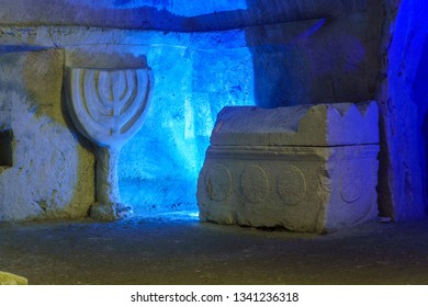 Kiryat Tivon, Israel - March 13, 2019: Sarcophagus (Roman period coffin) and a carved Menorah, in a Jewish burial cave, in Bet Shearim National Park (Jewish Necropolis), Northern Israel
