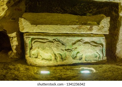 Kiryat Tivon, Israel - March 13, 2019: Sarcophagus (Roman period coffin) with carving of two lions, in a Jewish burial cave, in Bet Shearim National Park (Jewish Necropolis), Northern Israel