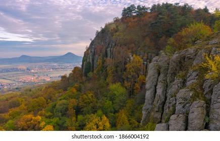 Kisapati, Hungary - Aerial panoramic view of volcanic basalt organs at Szent Gyorgy-hegy with moody tones, warm autumn colored trees. Szent György-hegy, Kisapáti, bazaltorgonák.