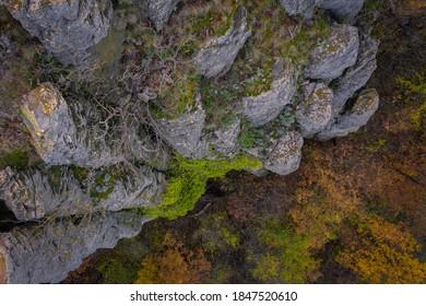 Kisapati, Hungary - Aerial view of volcanic basalt organs at Szent Gyorgy-hegy near lake Balaton with moody tones and warm autumn colored trees. Szent György-hegy, Kisapáti, bazaltorgonák.