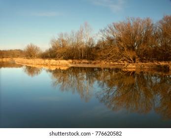 Kishwaukee River under evening sunlight in Illinois
