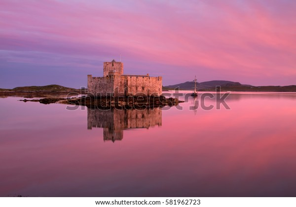 Kisimul Castle on Barra in the Outer Hebrides of Scotland is a formidable fortress founded in 1039 as a power centre of the MacNeil Clan and situated on an islet facing the village of Castlebay.