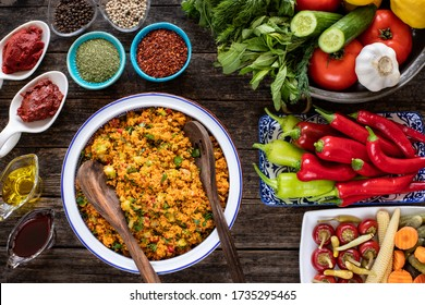 Kisir, a traditional vegan salat prepared from bulgur wheat, tomato, parsley, olive oil and spices. Top view of a kisir salat on the wooden table.   - Shutterstock ID 1735295465