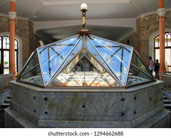 Kislovodsk, Russia - July 7 2008 : Interior of the 19th-century building of Narzan Gallery, marble walls and pillars and mineral spring with glass dome in the historical center of the city