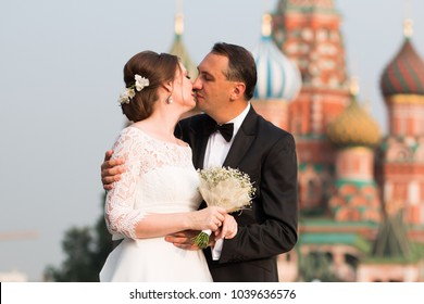 Kiss Of 40 Year Old Bride And Groom On Red Square In Moscow