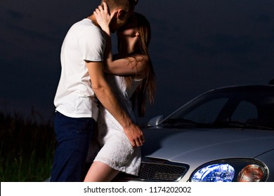 Kiss the night near the car
