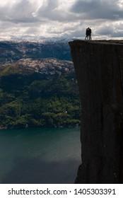 A kiss on the edge. The Pulpit Rock (Preikestolen), Norway