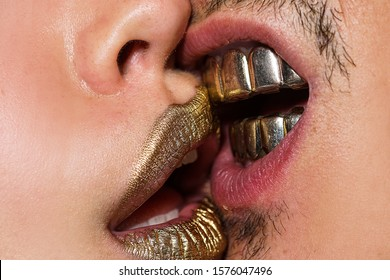 Kiss with passion. Sensual couple kissing. Gold lips and teeth clous up. Luxury and gold. Passion love. Couple in love