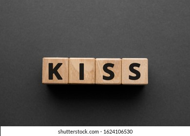 KISS - words from wooden blocks with letters, keep it simple, stupid KISS  concept, top view gray background