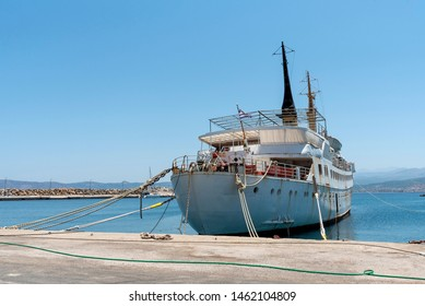 Kissamos, Crete, Greece. June 2019.  An old and retired passenger ferry stern in to the harbour wall in the port of Kissamos near Kastelli, western Crete.