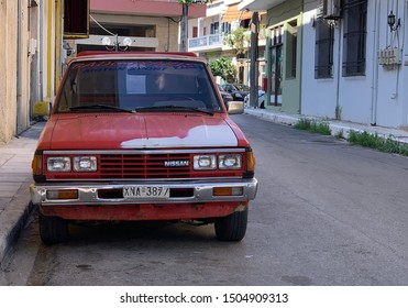 KISSAMOS, CRETE, GREECE - SEPTEMBER 2019: Old classic pickup truck parked on the streets of Kissamos, Crete.