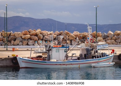 Kissamos, Greece - May 19, 2007: Fishing boat in Old Port in Kissamos town on a Greek Island of Crete
