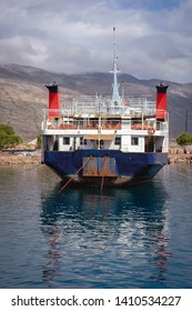 Kissamos, Greece - May 19, 2007: Ferry boat in Old Port in Kissamos town on a Greek Island of Crete