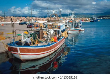 Kissamos, Greece - May 19, 2007: Fishing boats in Old Port in Kissamos town on a Greek Island of Crete