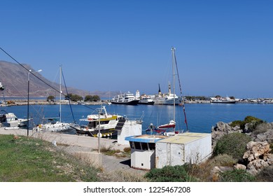 KISSAMOS, GREECE - OCTOBER 08: Different ships in the tiny harbor in the west of Crete near Chania, on October 08, 2018 in Kissamos, Greece