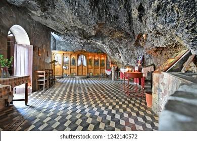 KISSAMOS, GREECE - OCTOBER 08: Inside tiny cave church of Agios Ioannis aka Saint John in Crete, on October 08, 2018 in Kissamos, Greece