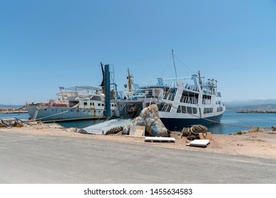 Kissamos Port, Kastelli, Crete, Greece. June 2019.  The Spirit of Athos a ferry and old ferry in a poor state of repair alongside and named Atlantis and Atlantic.